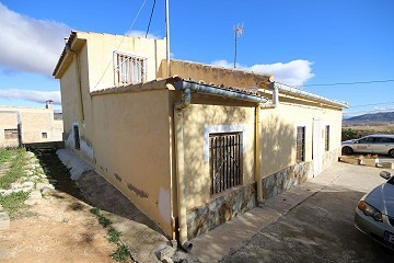 Village House in Casas del Señor with a courtyard and outside kitchen