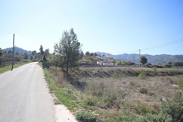 Building plot of land with tarmac access, views and close to town